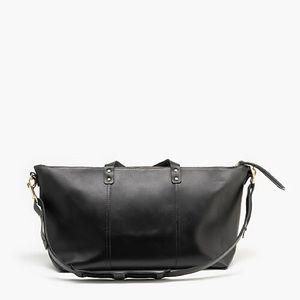J. Crew Tribe Alive black leather travel bag.
